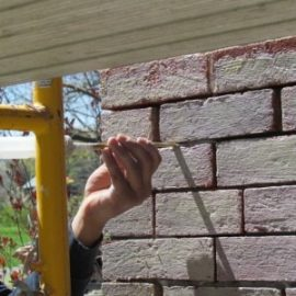 Fine Sand Lime Mortar repointing a butter joint with a syringe kit
